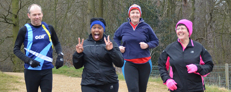 Four runners at Panshanger parkrun